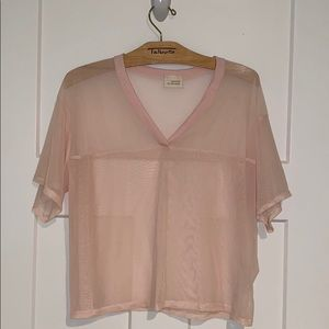 A cute light pink mesh-see-through shirt
